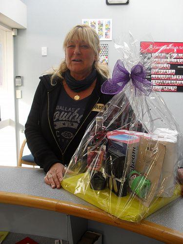PIA raffle winner Peg Bilkey accepts her prize