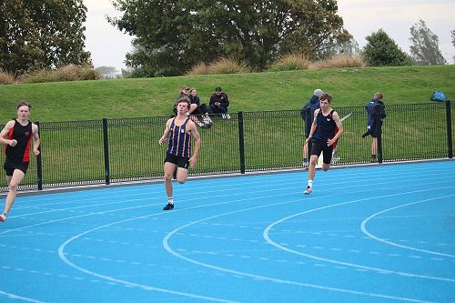 William Laing on his way to winning the Under 16 400m