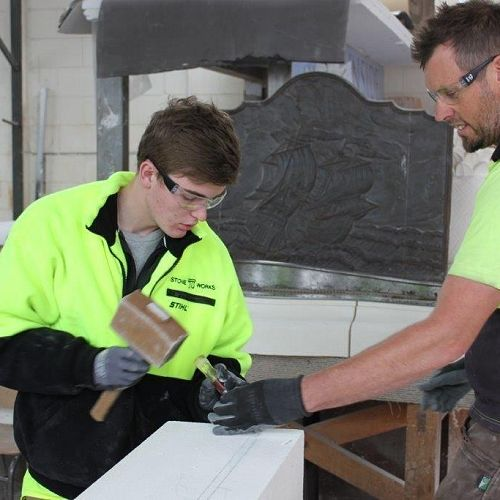 """Ryan McFarlane learning the skills of a stonemason for an upcoming episode of the """"Just the Job"""" television series"""