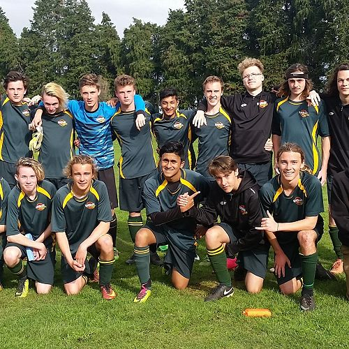 1st XI Boys' Football team with Principal and fan, Carolyn Pentecost (far right)