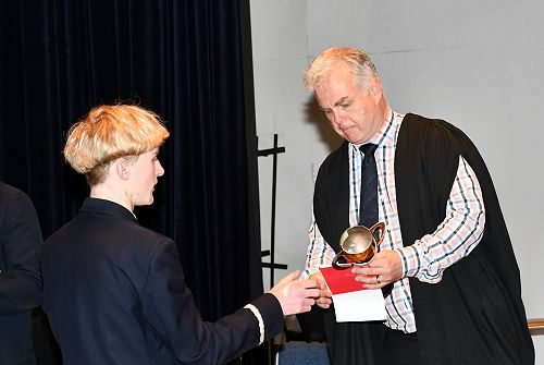 Max Gray recieves trophy for singing