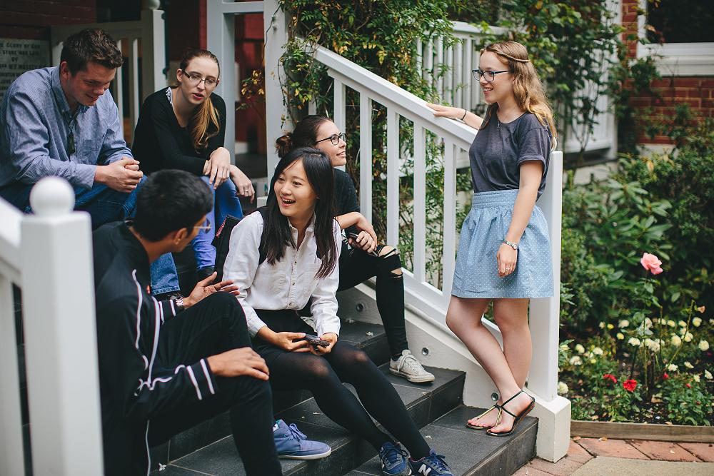 Socialising on the front steps of the College