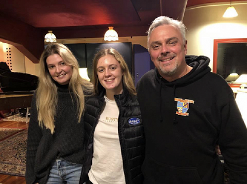 Caitlin Bradley (centre) with established members of the New Zealand music scene, (from left) alt country award winning guitarist and singer/songwriter Jamie McDell and legend Rikki Morris.