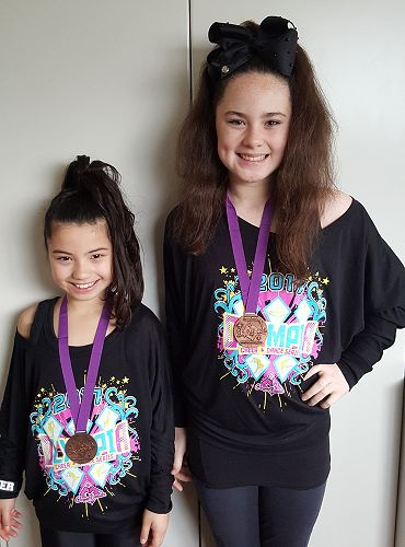 Elena & Lila with their medals!