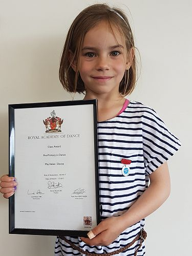 Mia with her Certificate