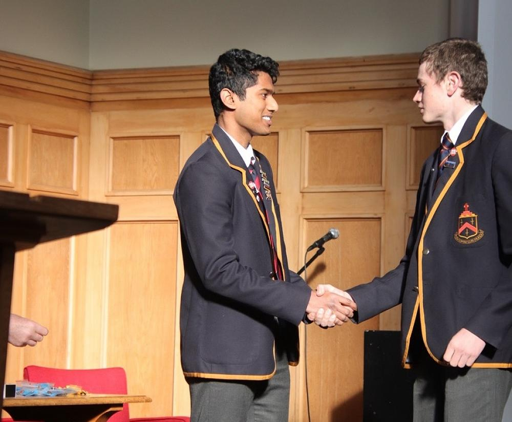 Darcy Neville receiving his Level 1 Excellence Endorsement Badge from head boy, Krishan Luxmanan.