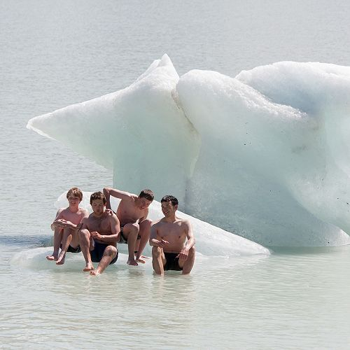 Lachlan Kenneally, Andrew Hughes, Tom Shallard and Mr Brown have a brief rest in the sun on the iceberg.