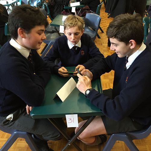 Robert Millar, Cameron Leydon and Ned Hancoxwaiting patiently for the start of the Year 9 & 10 ODT Social Studies Quiz