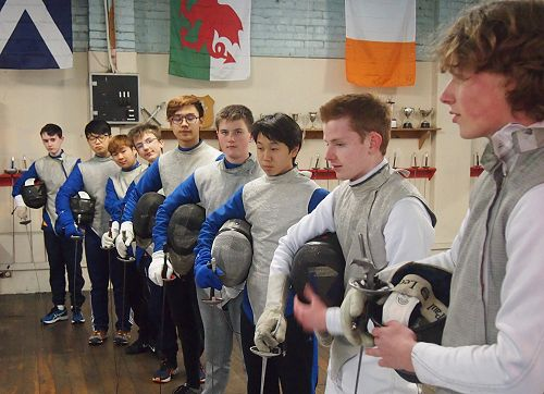 The McGlashan fencers suited up with weapons, mask