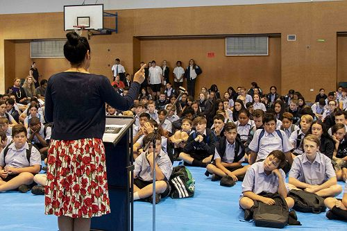 The Principal, Mrs Crawford, addressing the new students at their first school assembly.