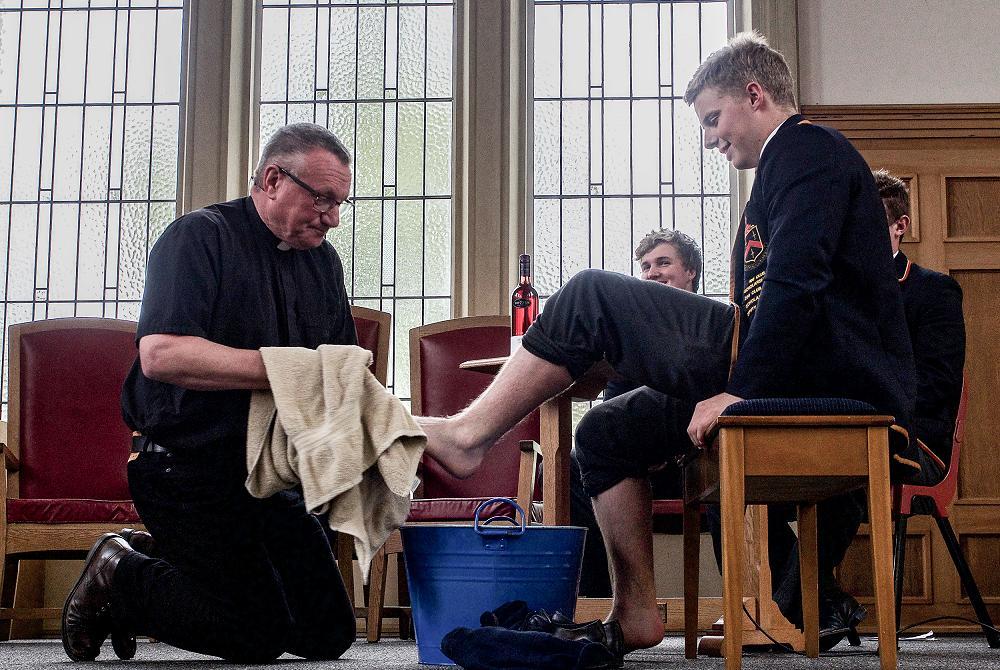 Easter 2017; Rev washes Charlie Baker's feet.