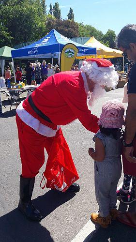 Even Santa loves the GI Market day. Dec 2017.
