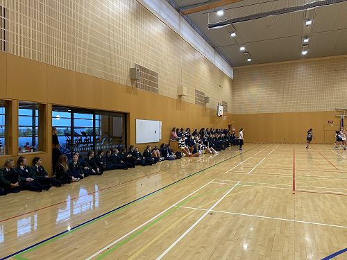 Columba students supporting the Senior A Netball team