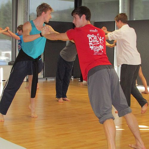 RNZB dancers Loughlan and William look on to check how the students are coping with the counterbalance exercises