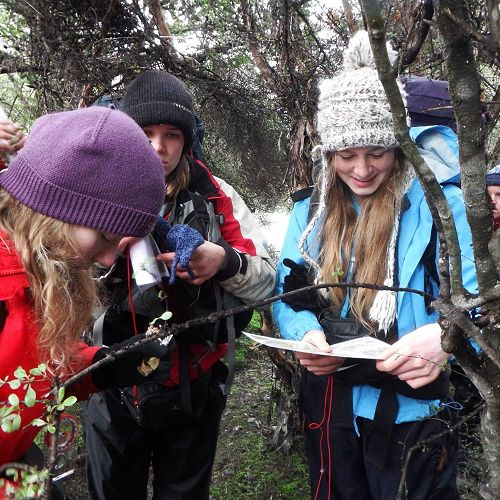 Sophie Madsen (centre)  using a compass to find a track