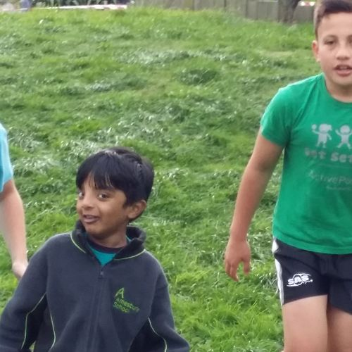 Vishakan running his first Cross Country at Amesbury School with senior students, Chris and Khan