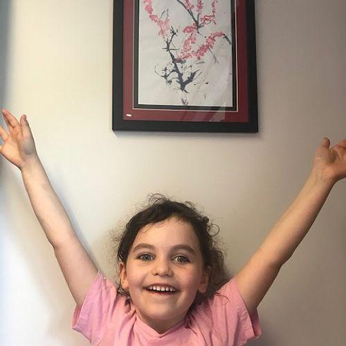Nina with her artwork