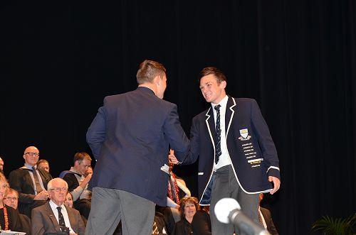 Handing over the reins over, Mitch Pryde congratul