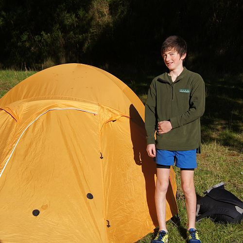 Zack stands beside his group's tent as 9GAV finally get to see the Sun