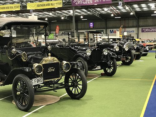 Model T Fords and a Packard