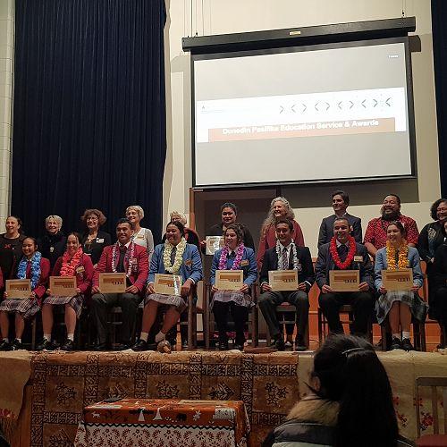 Choko Metua (second from left) receiving the award on behalf of Chenoa Metua