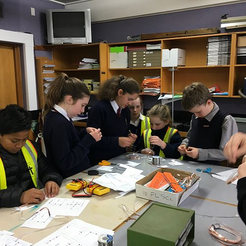 Kavanagh and Saint Mary's students working together to make circuits.