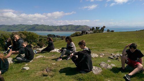 A great classroom! Stella Tamatea and Thomas Kerr near Taiaroa Head on the ecology/taxonomy workshop.