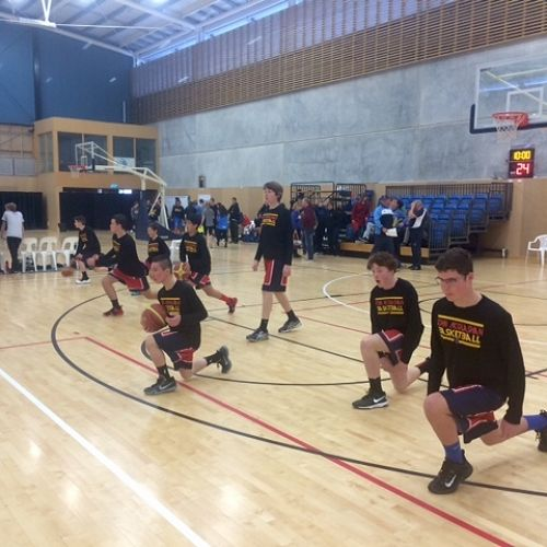The U/15 A basketball team warming up before a game during tournament week in Nelson.