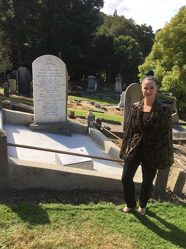 Lisa Breen, Hope and Sons Mosgiel based funeral director standing beside the restored grave