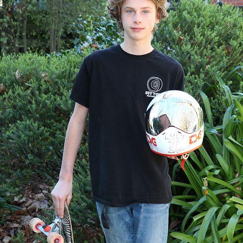 Finn Gray-Swann with his Skateboard and racing helmet