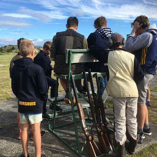 John McGlashan College students gather round to assess the scores of their first shoot of the season