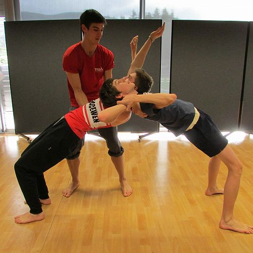 RNZB dancer William helps Saba and Fraser with one of the moves