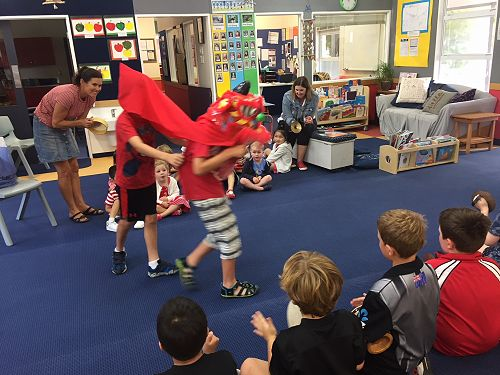 Year 4 boys perform a dragon dance to the Pre-school