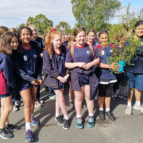 Krystal-Lee Boyd 7DGR holding a miro sapling moments before we were called onto the marae.