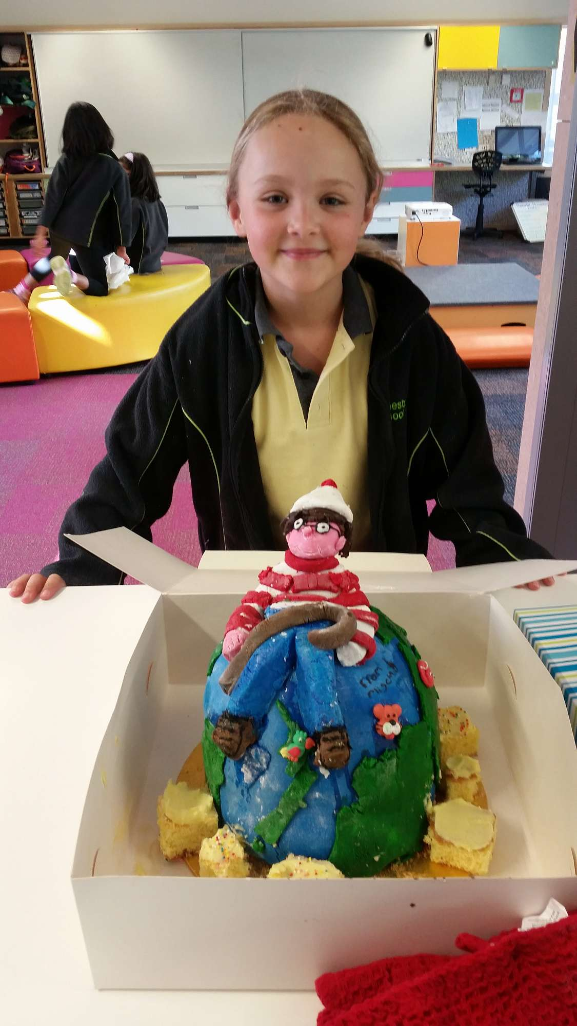 Mischa, with the amazing 'Where's Wally?' cake she made with Kirsty for our Living Globally inquiry.