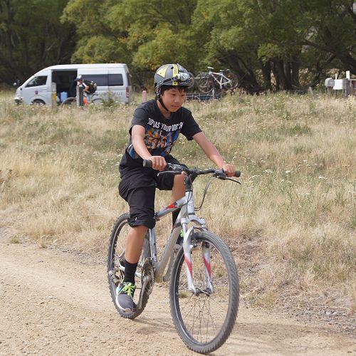Aidan Hung biking confidently through the Ida Valley