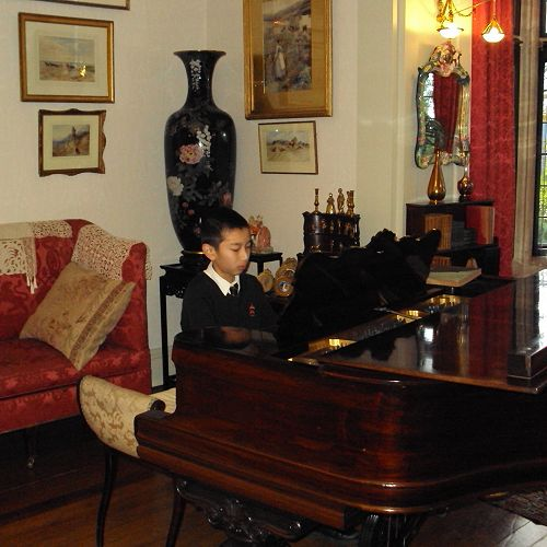 Gary Yao impresses with his skills on the Steinway.