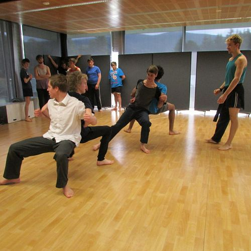RNZB dancer Loughlan Prior watches over the senior drama students as they try the counterbalance exercises