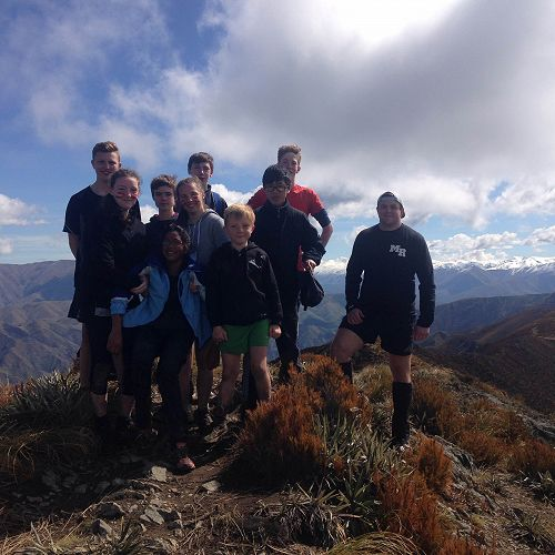 The summit of Little Mt Peel. (l-r) Toby Buckner, Aislinn Rogers, Will Semple, Anusha Raazesh, Leah Albrow, Luke Brennan, Nicholas Gordon, Owen Tsai, Campbell Madsen and the intrepid Mr Hammond.
