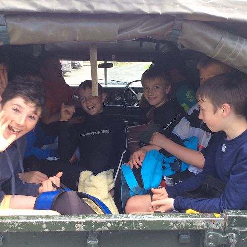 The army jeep takes the boys to their next activity