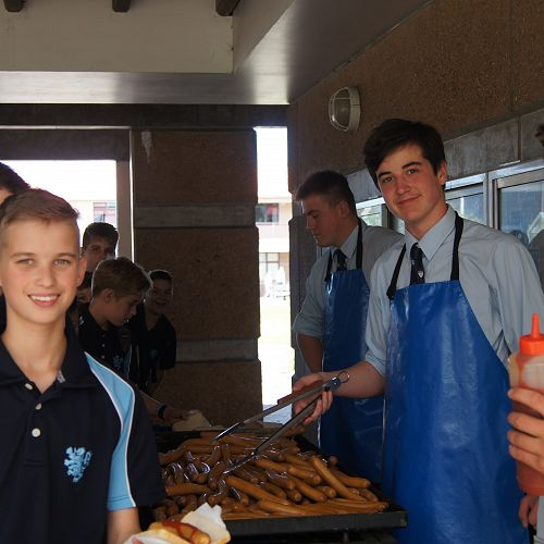 The student leadership team, from back left, Izaak Parata, Solomon Filipo and Nathan Hastie serve up lunch on day 1.