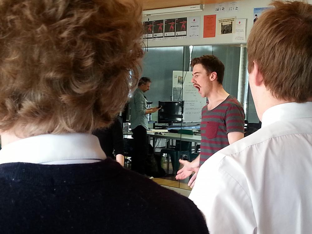 Fortune Theatre actor Simon Leary demonstrates vocal techniques with the senior drama class