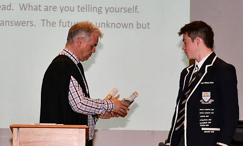 Cricket trophy being awarded to Charlie Marsh