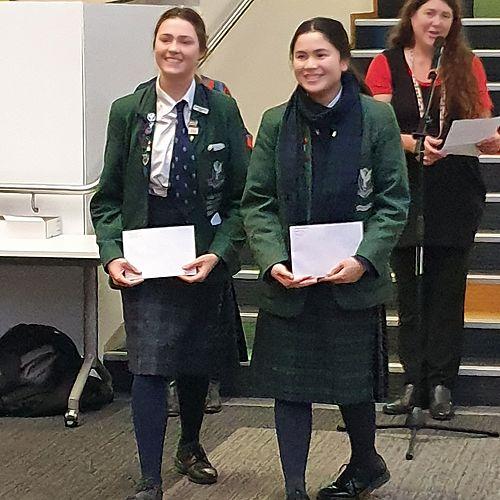 Amaya Leslie and Amelia Chang accepting thier awards.