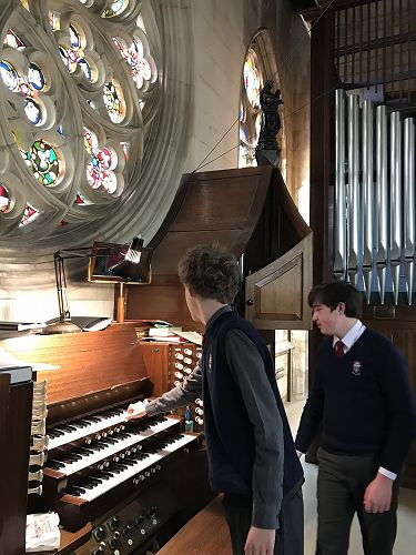Oliver showing Oscar the organ