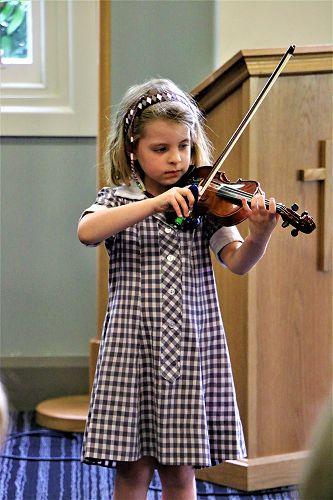 Itinerant Music pupils Junior School Assembly performance