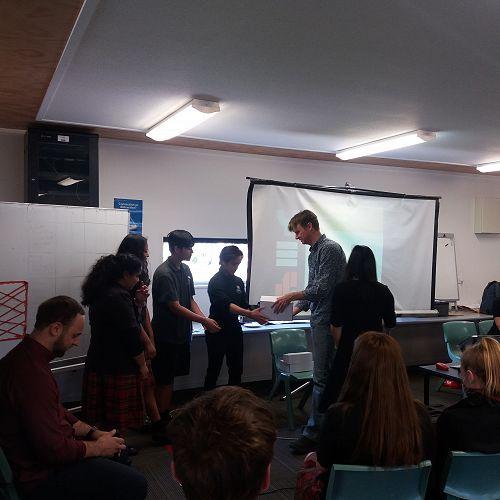 Ivo Baguingey, Tangkheng Rai, Ashlin Chandra and Heer Giroti getting their awards from Christian