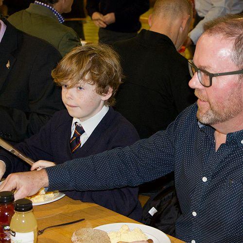 Theo Hannagan enjoys Men's Breakfast