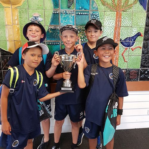 Some of the A Team cricket boys with the trophy!