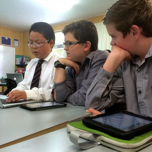 Coders ponder a programming problem (or were they just playing Minecraft?)